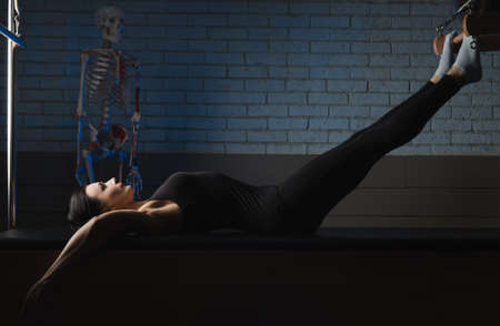 a woman is engaged in Pilates. fitness and sports