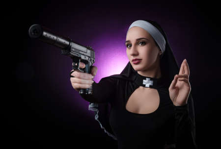 a nun with a weapon in the name of faith