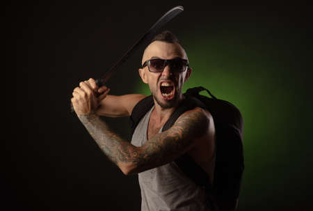 a man in a tank top with a machete, scream, emotions, Stock Photo