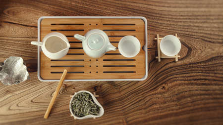 the tea table with instruments teapots cups and green tea