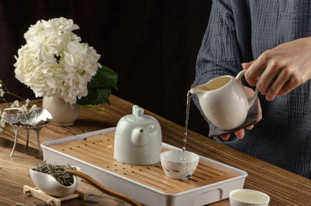 tea table with instruments teapots cups and green tea cooking process