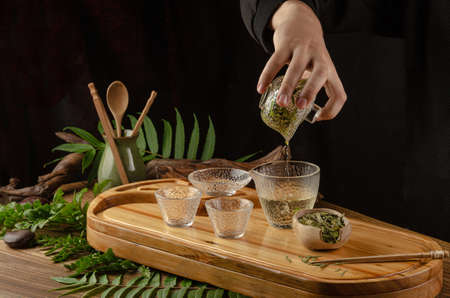 the tea table with instruments teapots cups pancake and tea Shen Puer