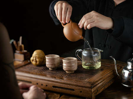 the tea ceremony hand men and women to pour the tea 写真素材