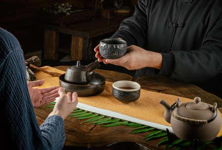 tea ceremony hand men and women to pour the tea