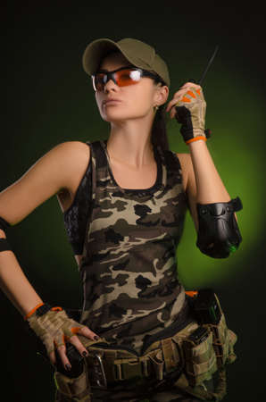 a girl in a military uniform helmet says on the radio