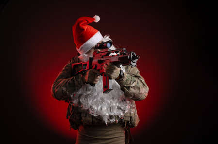 a man in a military uniform with a gun and a Santa hat
