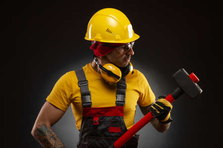 the male construction worker with a sledgehammer