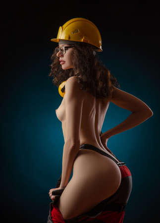 photos of naked girls in construction helmet and work clothes Archivio Fotografico