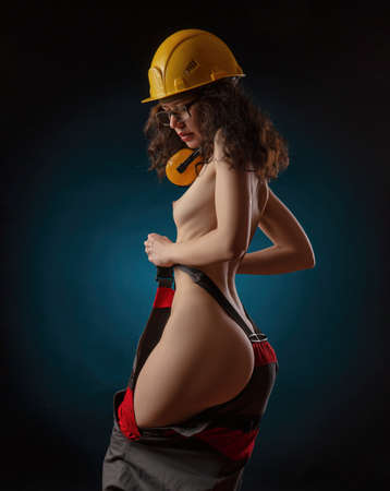 photos of naked girls in construction helmet and work clothes Standard-Bild