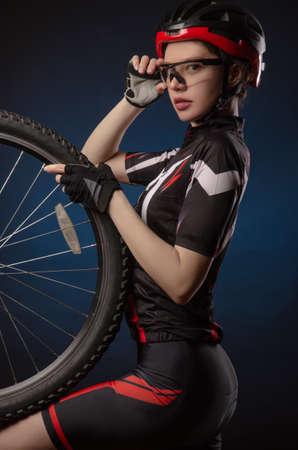 a girl cyclist in a helmet