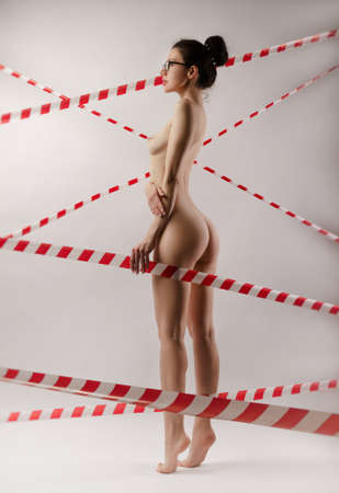 photo of Nude girl in the Studio on a white background Banque d'images
