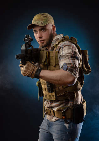 guys a military agent in a bulletproof vest with an automatic rifle Stock fotó