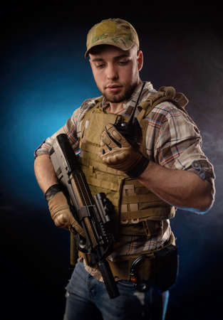 the guy's a military agent in a bulletproof vest with an automatic rifle