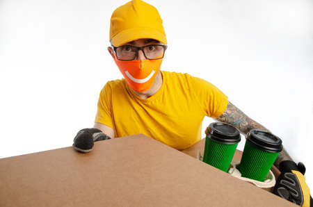 the guy delivering packages in a virus-proof mask, the courier with coffee and pizza
