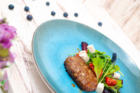 healthy food vegetarian cutlet decorated with greens