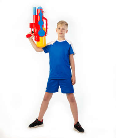 boy with water pistol on white background