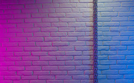 white brick wall texture with chain in neon light