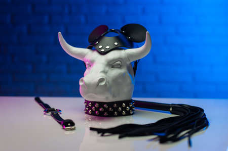 statuette of a white metal bull in a leather mask and accessories for BDSM games
