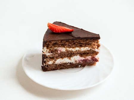 layered: Piece of layered chocolate cake with strawberry slice