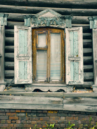 architectonics: Old wooden lace window with window shutters in Siberia,  Russia Stock Photo