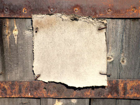 nailed: Abstract rusty grunge frame nailed down on wooden background Stock Photo