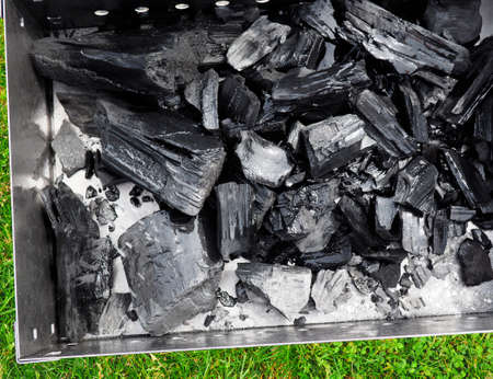 Close up view of coal for fast firing up a barbecue grill. texture Archivio Fotografico
