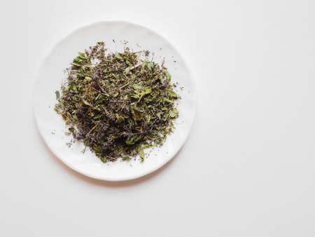 Pile of dried oregano leaves and flowers for herbal tea. Dried Origanum vulgare, pot marjoram on white background Zdjęcie Seryjne