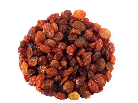 Sweet dry raisins in round shape isolated on white background