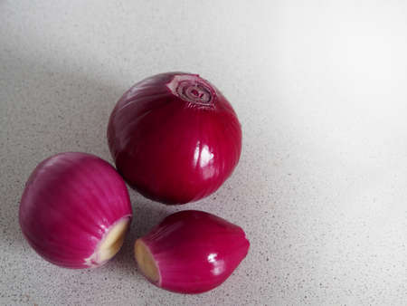 fresh red onions closeup on a gray marble background Stock Photo