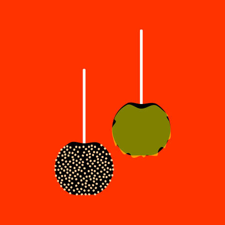 Candy apples with a stick inserted as a handle isolated on orange background.