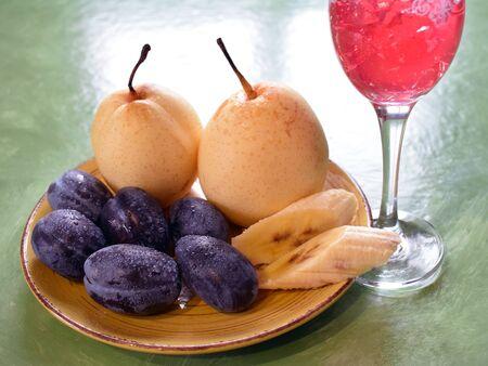 plums pears and wineglass 版權商用圖片