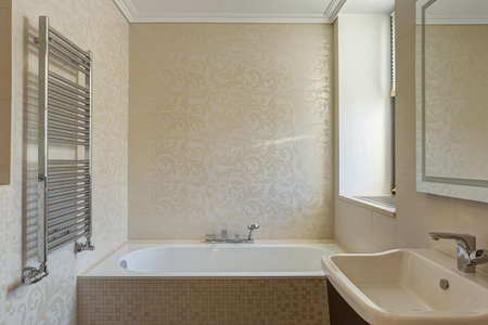 Bathroom in beige and white colors. Imagens