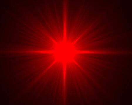 radiate: red radiate flare on the dark background Stock Photo