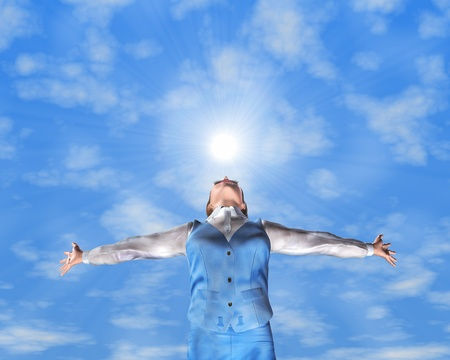 A young woman with arms stretched out to the sky Stock Photo