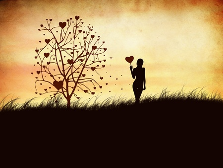 Silhouette of a girl with a heart and tree photo