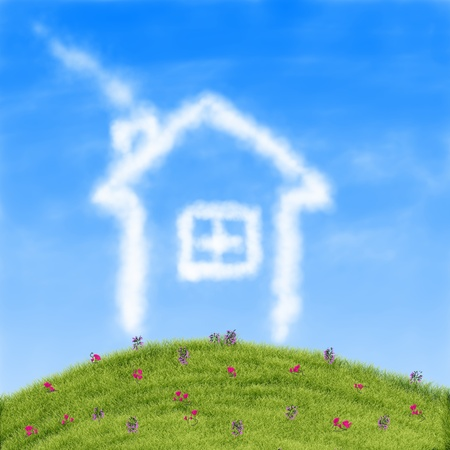 House of clouds in the blue sky against a background of green grass  photo