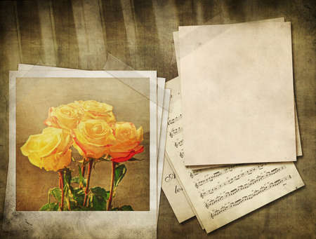 Grunge yellow roses and music sheet vintage background.