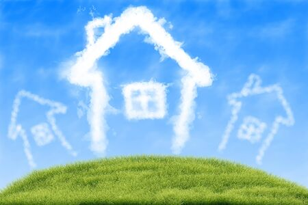 House of clouds in the blue sky against a background of green grass. Stock Photo - 14388182