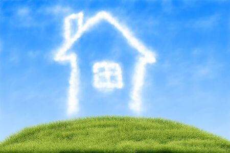 House of clouds in the blue sky against a background of green grass Stock Photo - 15058660