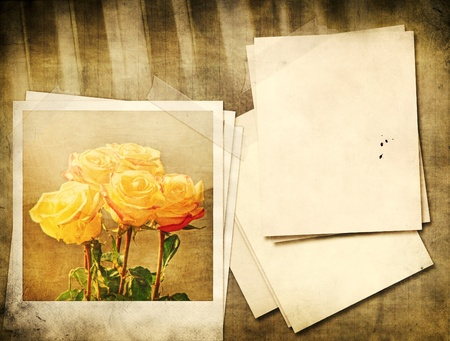 Grunge yellow roses and piano vintage background. photo