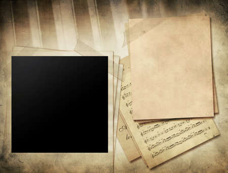 Grunge musical background - piano keys, sheet music and blank photo