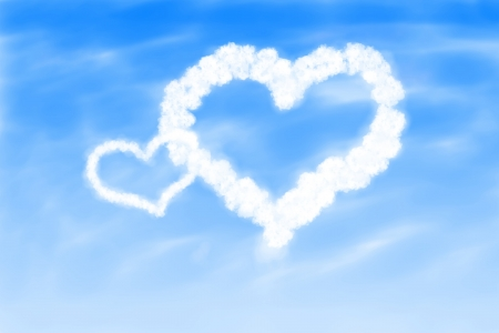 Image of hearts in the blue sky against a background of white clouds  photo