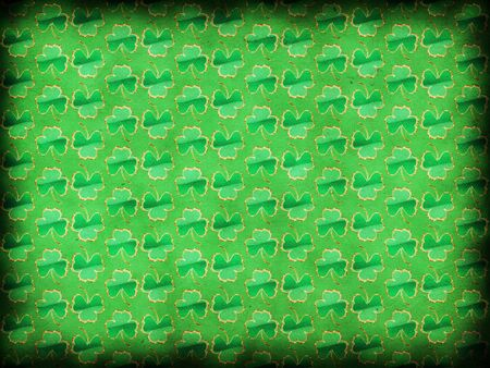 Illustration of grunge green background with shamrock or clover.