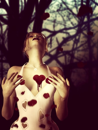 3d woman with bloody heart and rose petals over dark forest background. Stock Photo