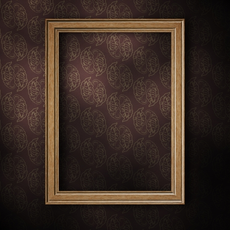 Old wooden photo frame on grunge wallpaper background. Stock Photo - 18117278
