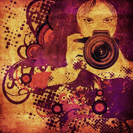 Girl photographer with camera in hands on abstract grunge background.