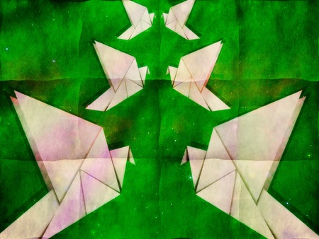 White folded paper, origami pigeon on grunge green background. photo
