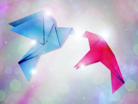 Pink and blue origami pigeons on grey background. photo