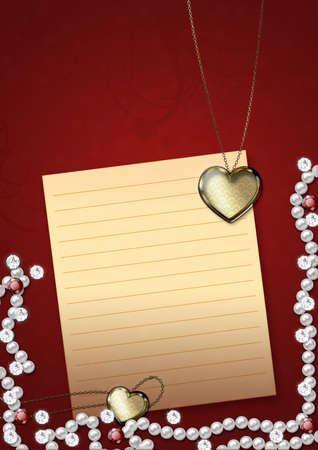 Card with heart shaped pendant, white pearls and sheet of paper. photo
