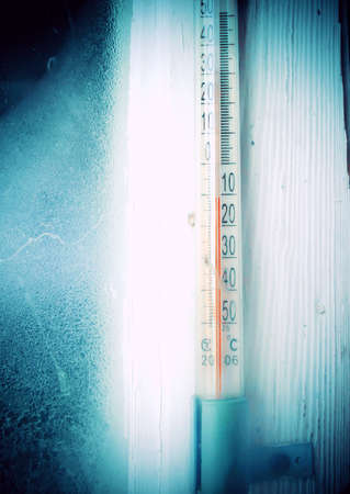 Thermometer outside during the winter time, cold weather.